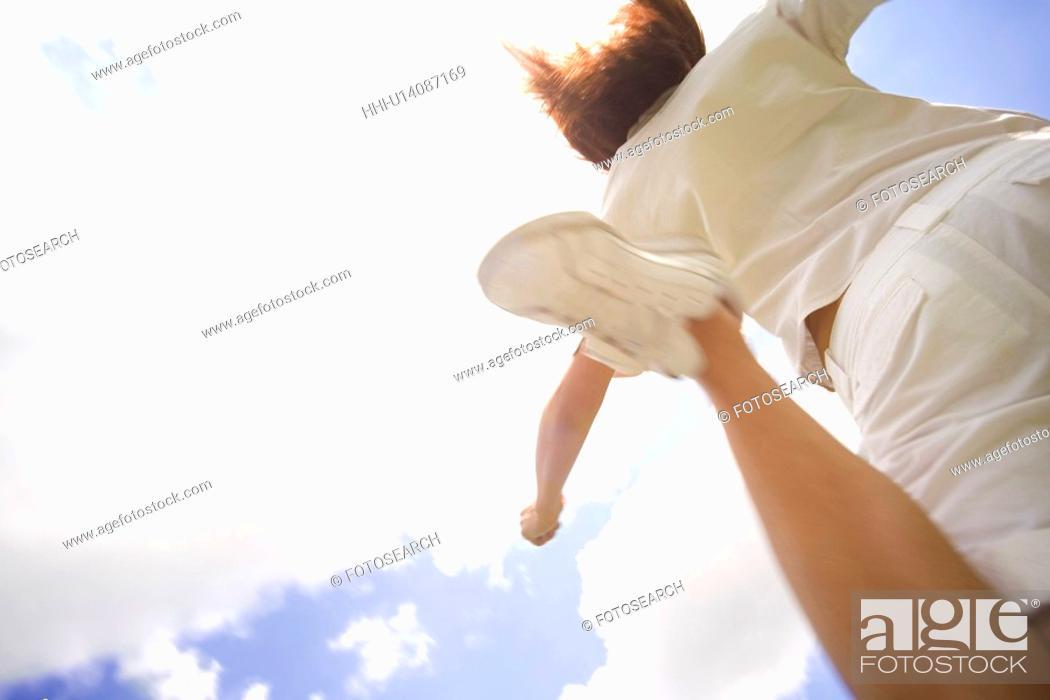 Stock Photo: Woman jumping.
