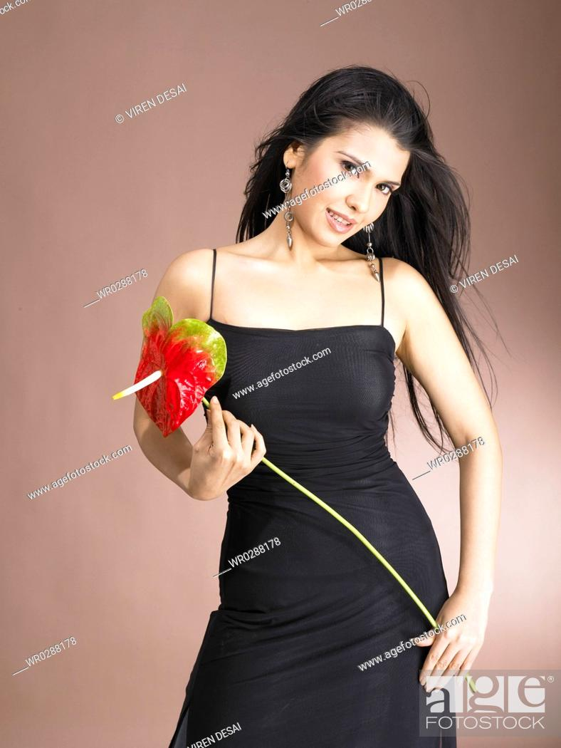 Stock Photo: South Asian Indian woman holding anthurium flower MR 702.