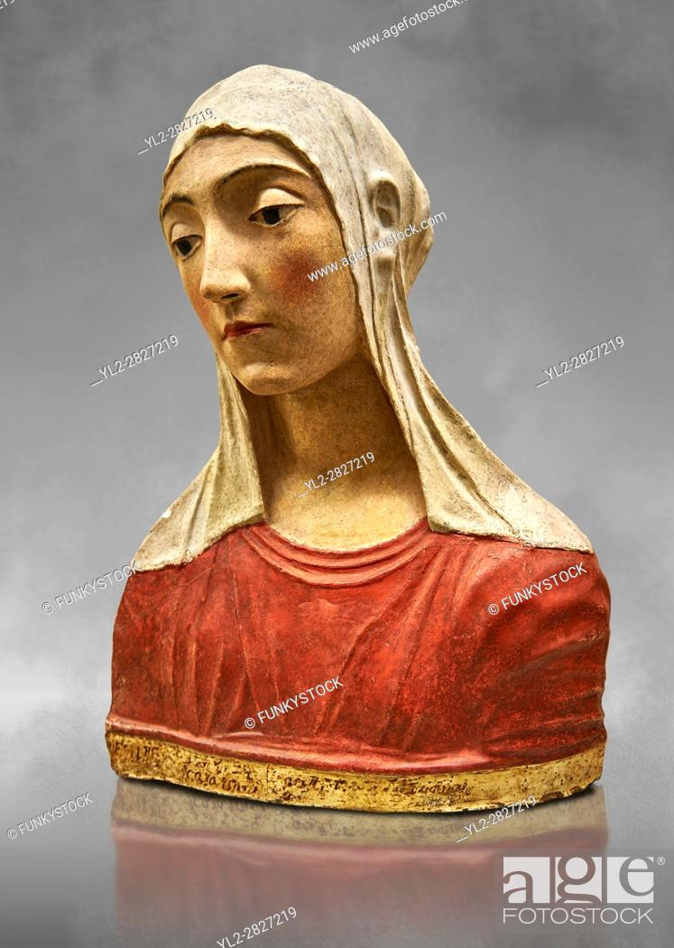 Stock Photo: Painted stucco bust of a female possibly the Virgin of the Annonciation or Saint Catherine of Sienna. made in Florence around 1429- 1484 from Papiano.
