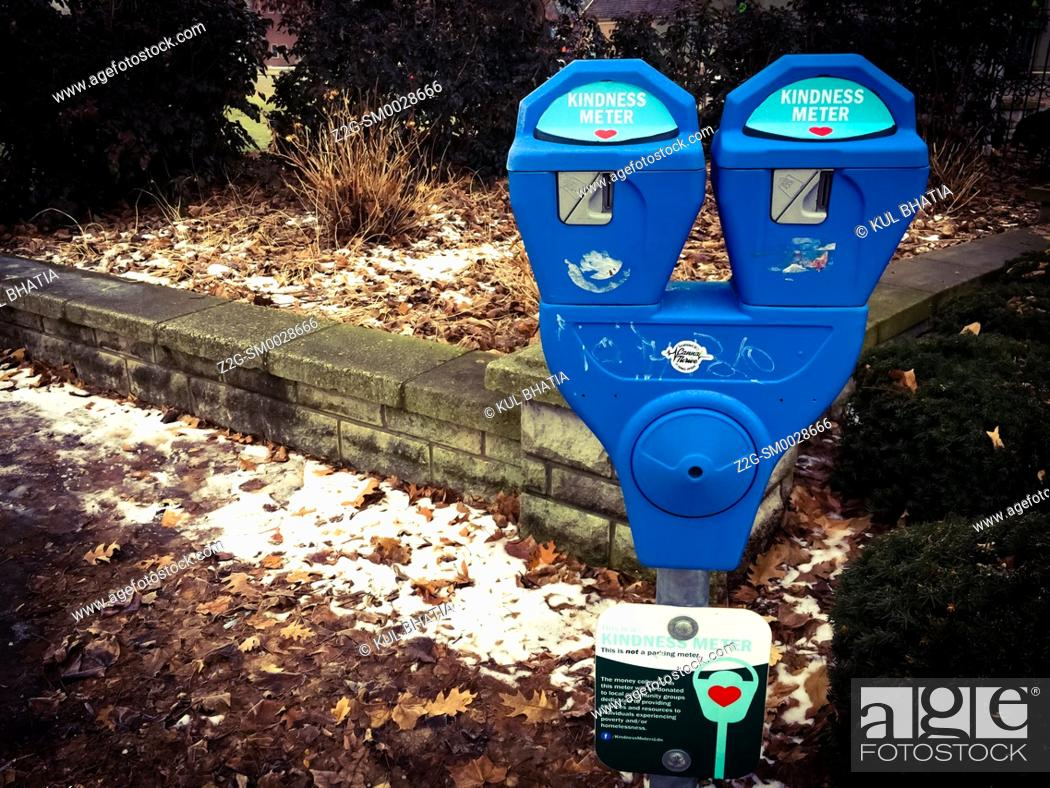 Stock Photo: A kindness meter, like a parking meter, to collect small donations for charity, Ontario, Canada.