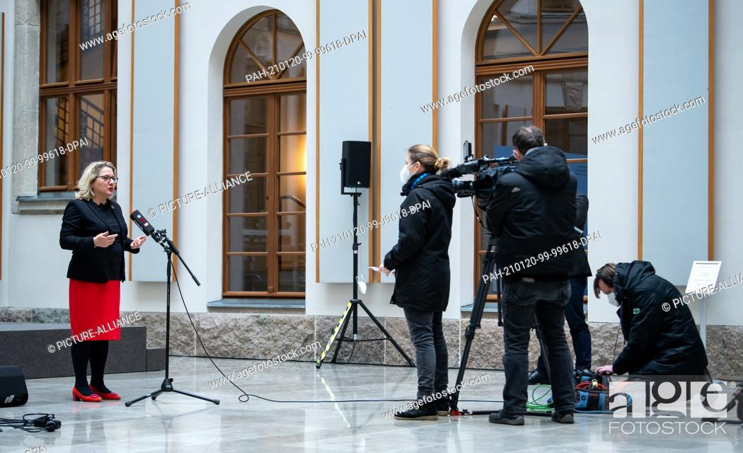 Stock Photo: 20 January 2021, Berlin: Svenja Schulze (SPD, l), Federal Minister for the Environment, is interviewed by a television crew after an online press conference on.