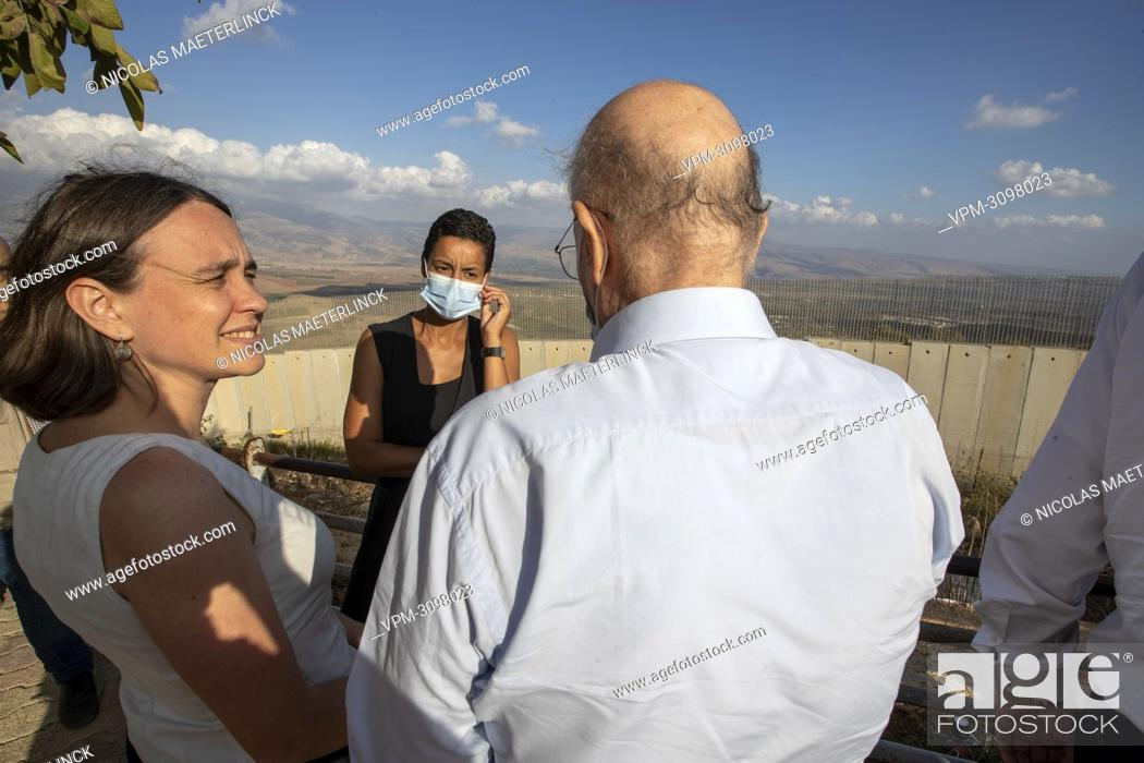 Stock Photo: Doctor Kamel Mohanna, founder and president of NGO AMEL (R) and Minister for Development Cooperation Meryame Kitir (C) talk during a visit to the 'Blue Line'.