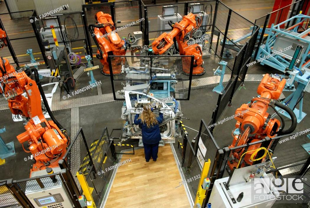 Stock Photo: Operator, Volvo component factory and robot cells from ABB, car manufacturing, Olofström, Sweden.