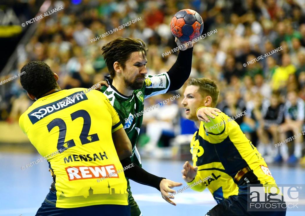 Stock Photo: 13 May 2018, Germany, Berlin: Handball: Bundesliga, Fuechse Berlin vs Rhein-Neckar Loewen at Max-Schmeling-Halle: Berlin's Fabian Wiede (C) in action against.