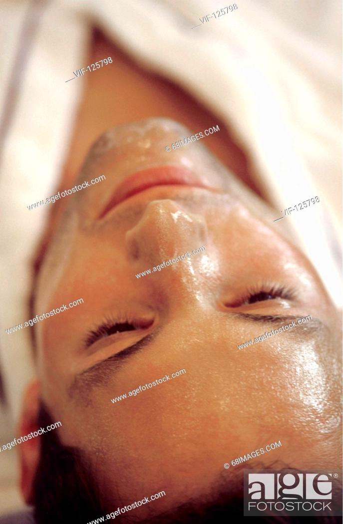 Stock Photo: Wellness - Muk Abhyanga - young man relax after a facial massage. - HAMBURG, GERMANY, 20/09/2005.