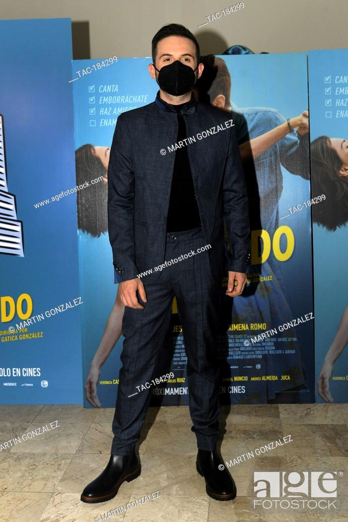 Stock Photo: MEXICO CITY, MEXICO ñ DECEMBER 14: Jesus Zabala poses for photos during the red carpet of film premiere Dime Cuando Tu at Cinepolis Diana on December 14 2020 in.