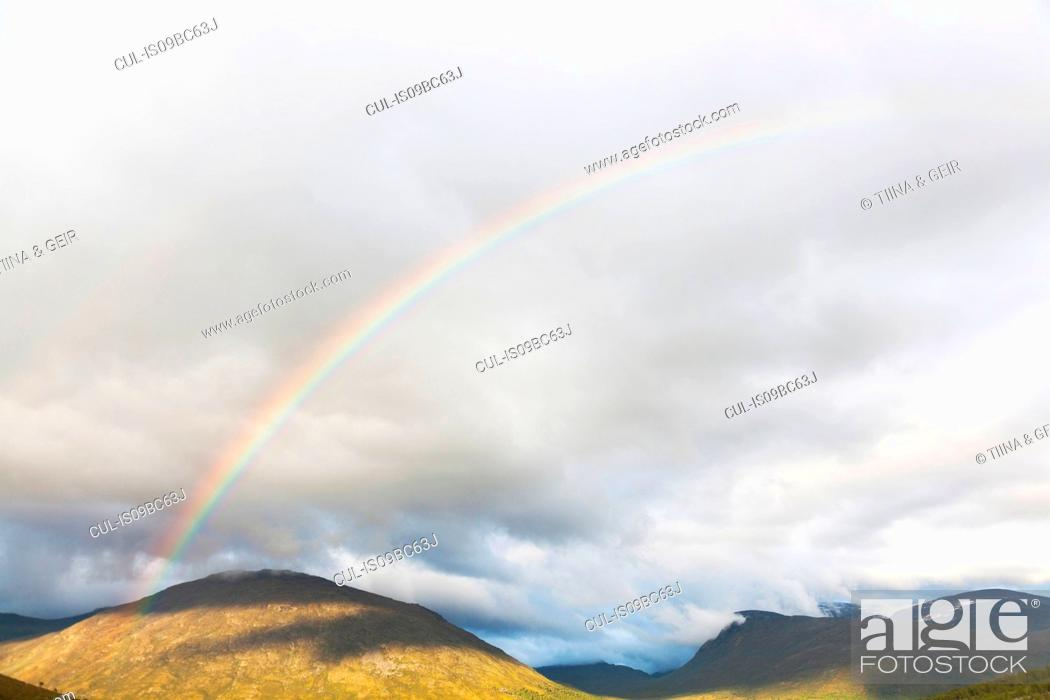 Stock Photo: Rainbow over mountain landscape, Jotunheimen National Park, Lom, Oppland, Norway.