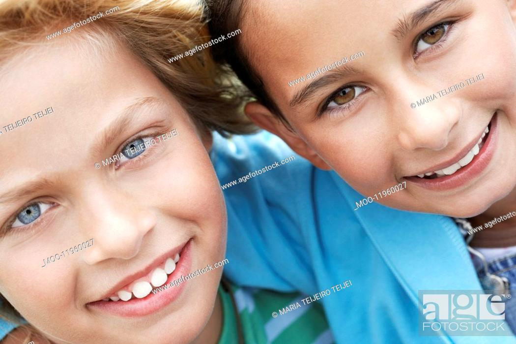 Stock Photo: Smiling pre-teen friends arms around close-up.