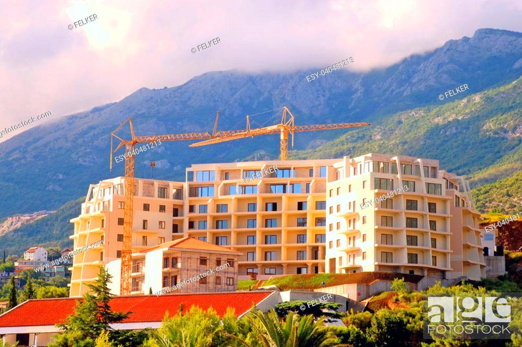 Stock Photo: Construction of modern building on green scenic hills on green scenic mounains(Montenegro).