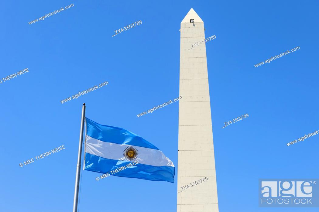 Photo de stock: Obelisk and Argentinian flag on Avenue 9 de Julio, Buenos Aires, Argentina.