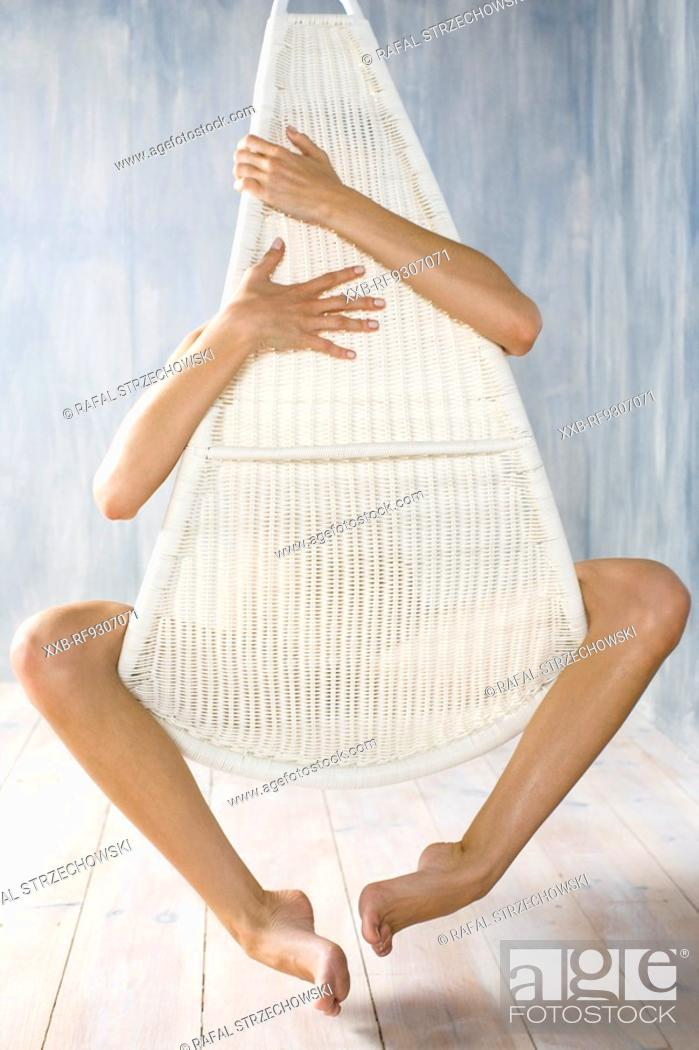 Stock Photo: nude woman behind a chair.