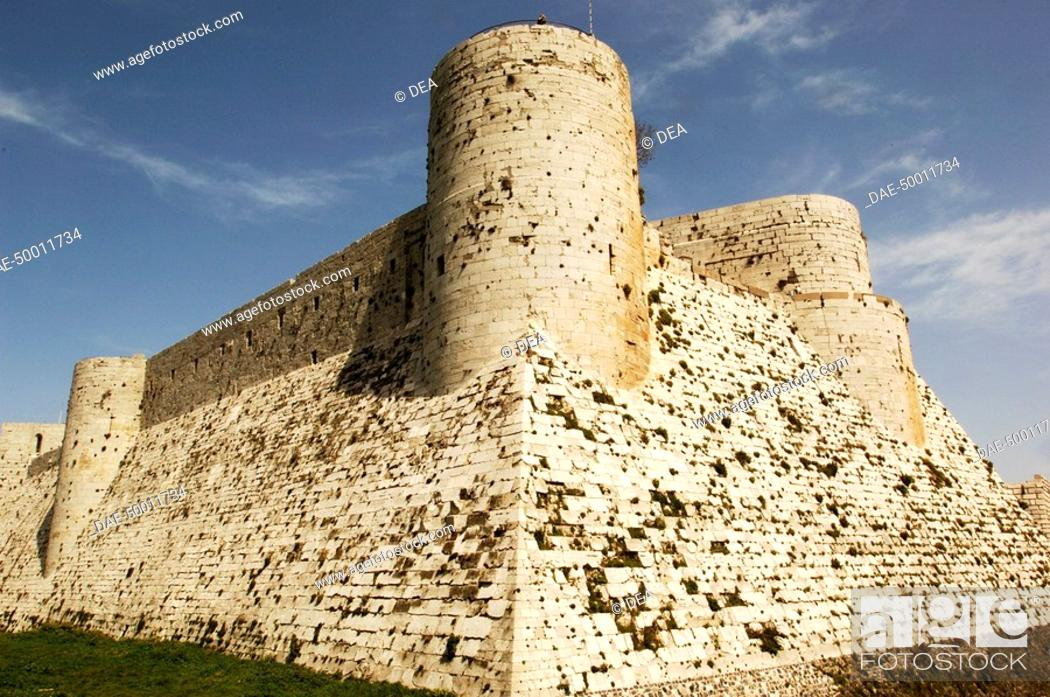 Stock Photo: Syria - Qal'at al-Hisn. Crac (Krak) des Chevaliers. UNESCO World Heritage List, 2006. Largest built Hospitallers fortress on earlier Muslim site.