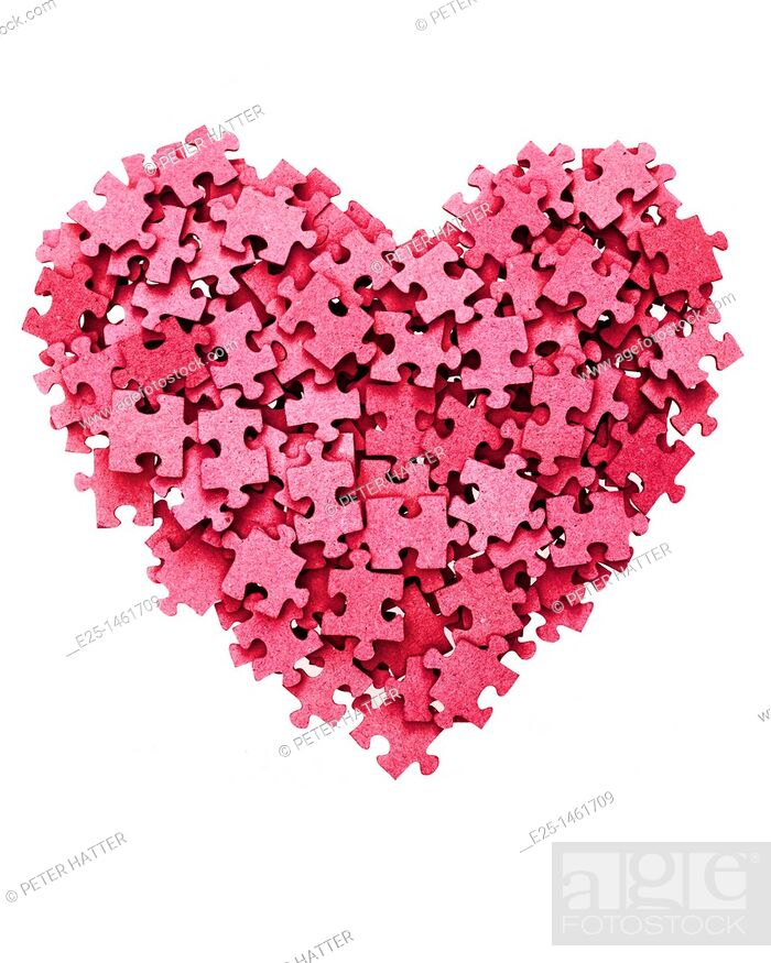 Stock Photo: Heart shape symbol made from blank red jigsaw pieces isolated on a white background.