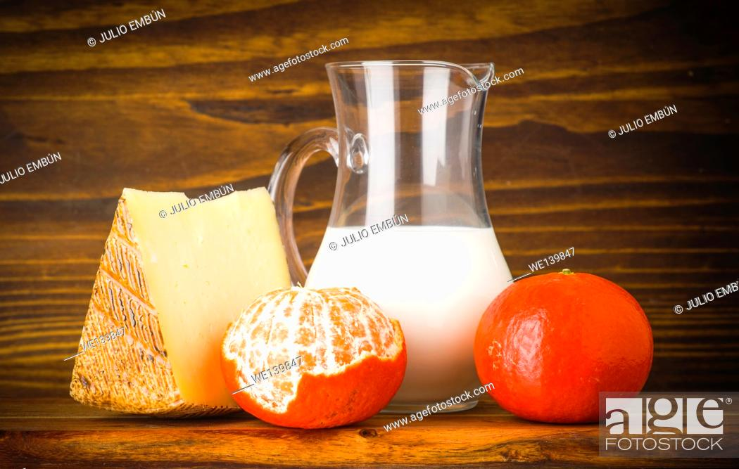 Photo de stock: eggs and milk cheese on rustic wood.