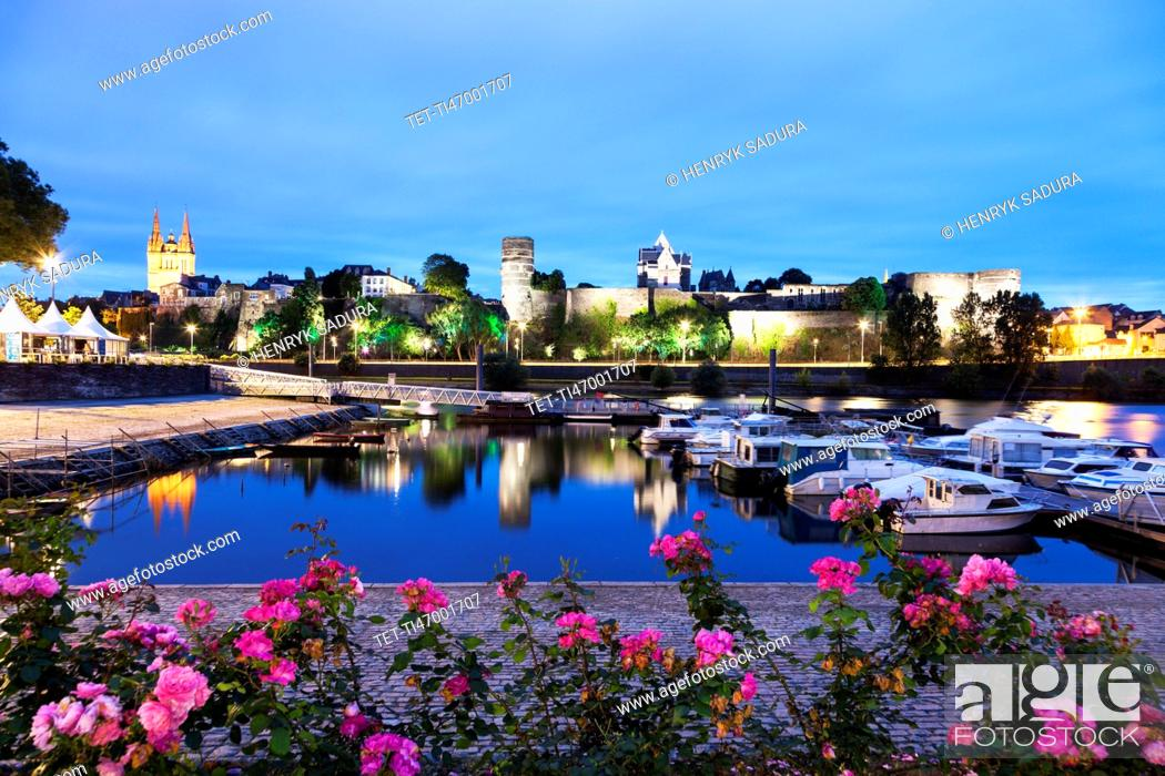 Imagen: France, Pays de la Loire, Angers, Harbor by Chateau d'Angers at dusk.