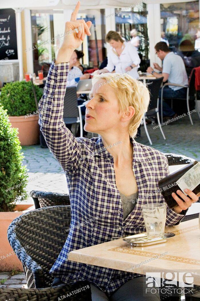 Stock Photo: Female customer calling waitress.
