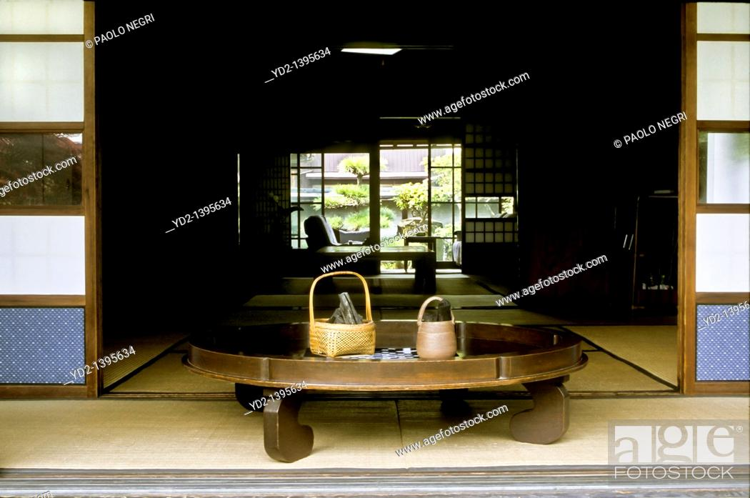 Stock Photo: round table with bambu basket and binchotan charcoal, private house, Japan.