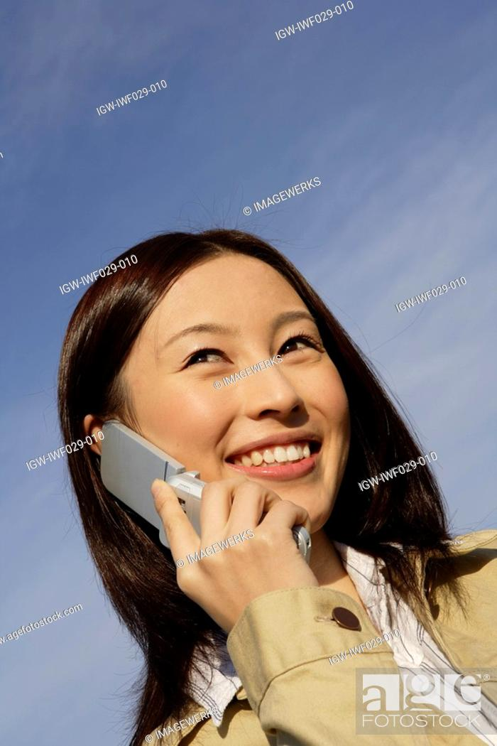 Stock Photo: View of a young woman using cellphone.