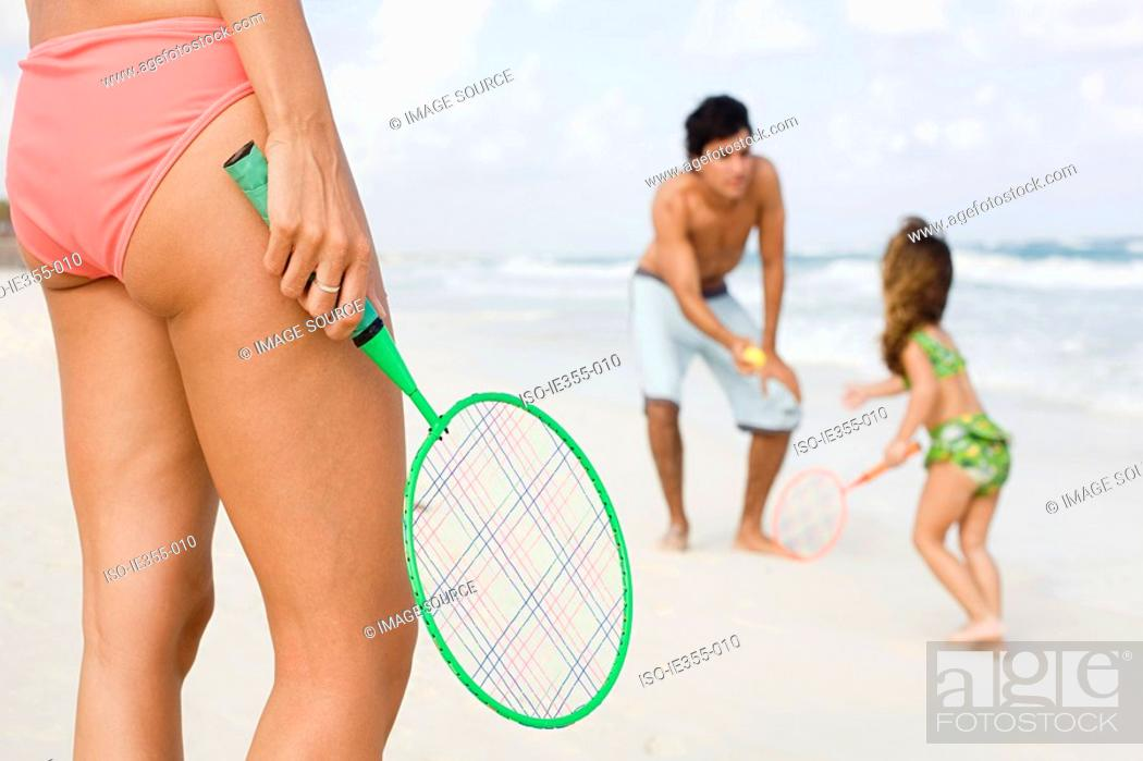 Stock Photo: A family playing tennis.