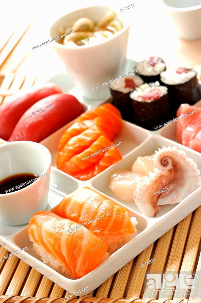 Stock Photo: sushi, maki and sashimi tray.