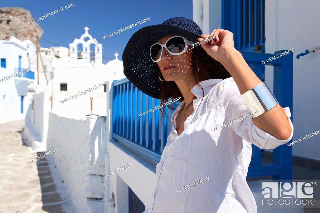 Imagen: Woman posing in Chora near a church, Amorgos, Cyclades Islands, Greek Islands, Greece, Europe.