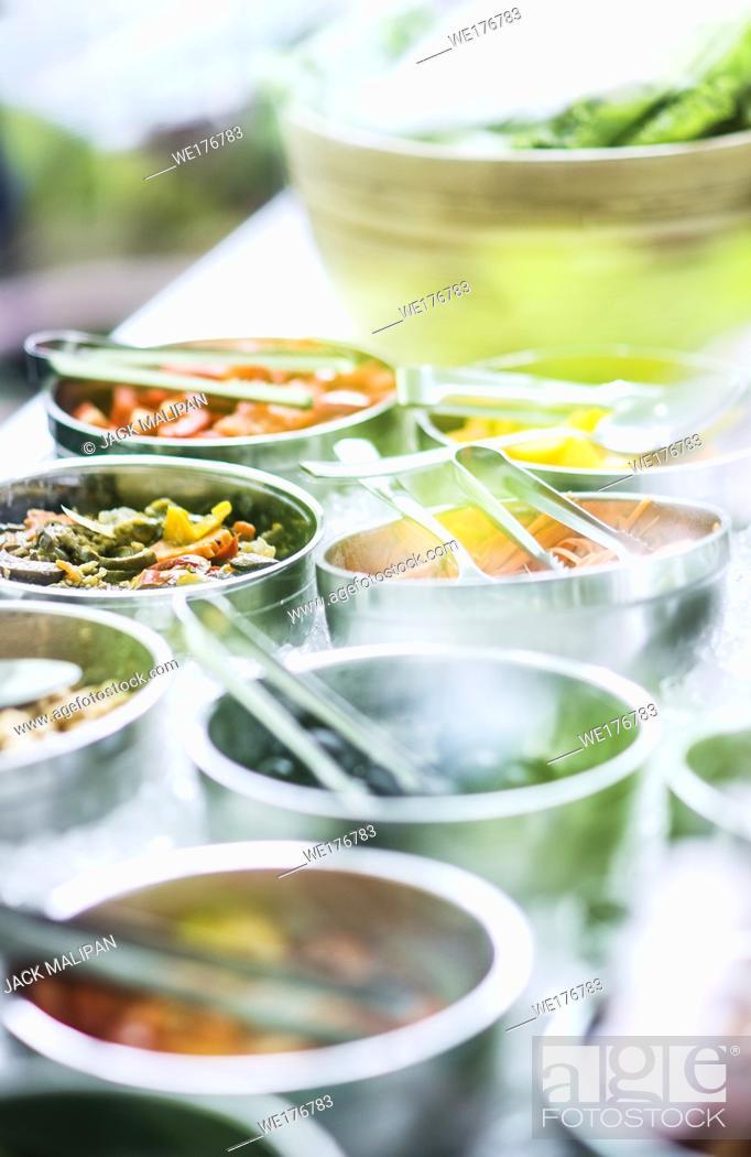 Stock Photo: bowls of mixed fresh organic vegetables in modern salad bar display.