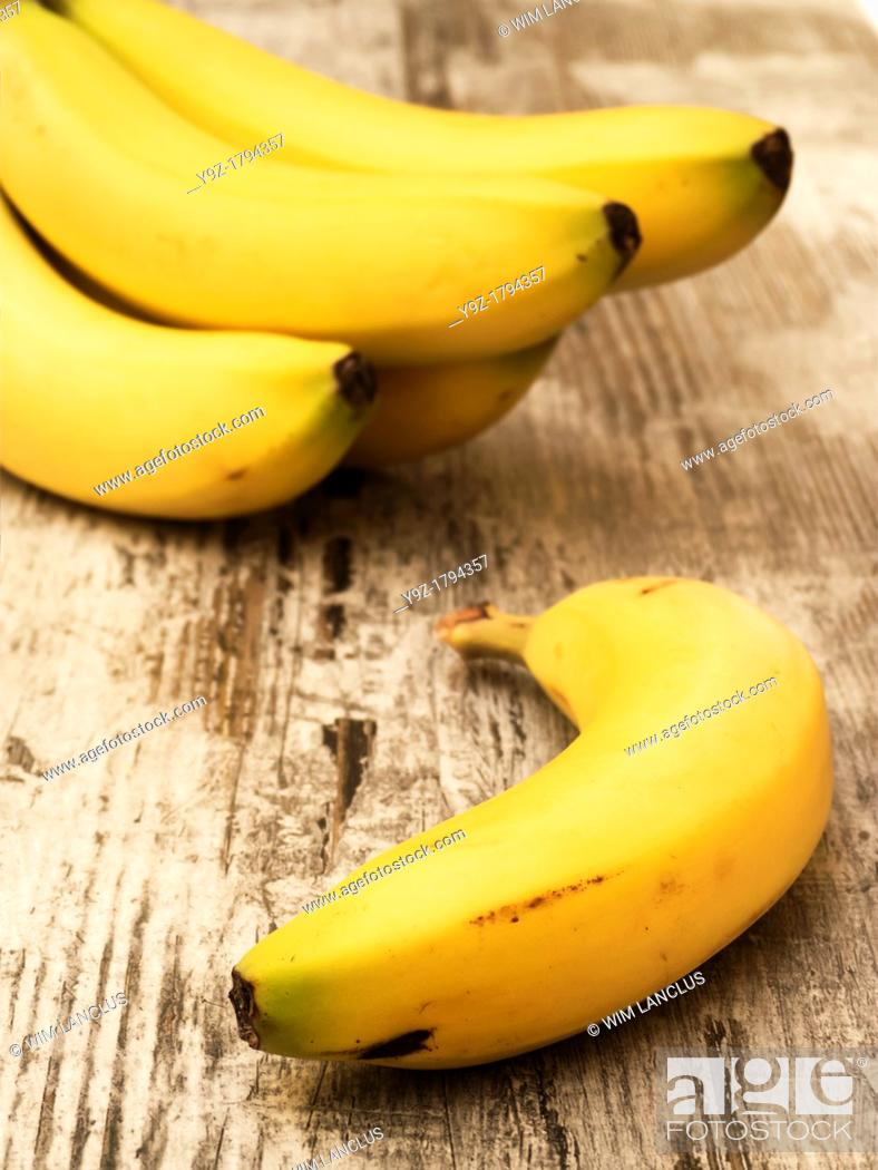 Stock Photo: Ripe bananas on wooden table.