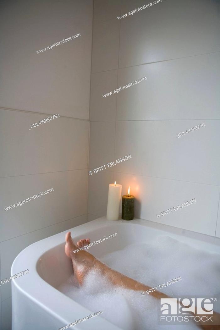 Stock Photo: Woman legs in bathtub.