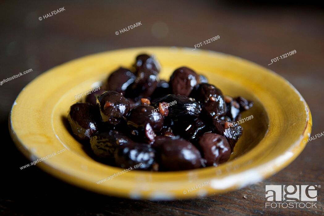 Stock Photo: Close-up of marinated black olives in plate.