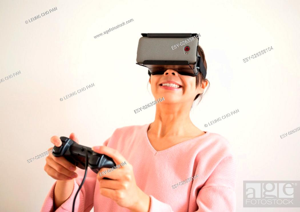 Stock Photo: Woman play with virtual reality and joystick.