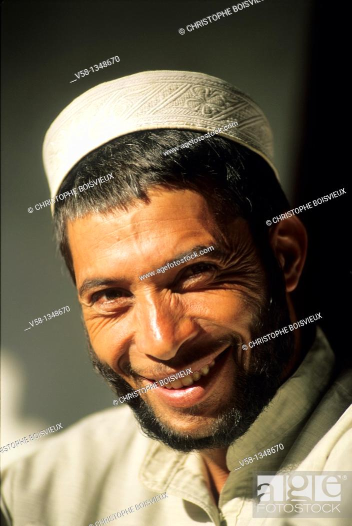 Stock Photo: Pakistan, Chitral region, Cheerful young man.