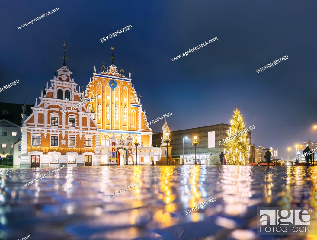 Stock Photo: Riga, Latvia. Panorama Of Town Hall Square, Popular Place With Famous Landmarks On It In Bright Evening Illumination In Winter Twilight.