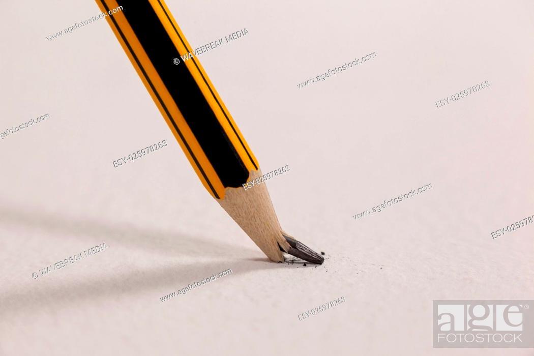 Stock Photo: Broken pencil on white background.