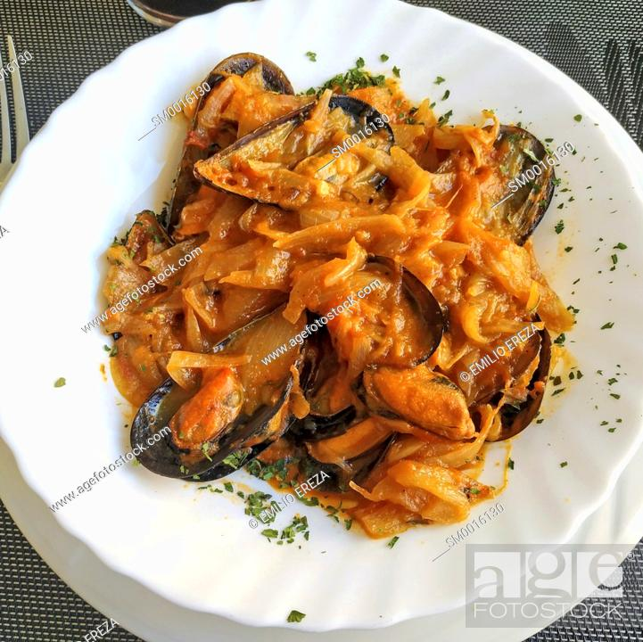 Stock Photo: Mussels with caramelized onions.