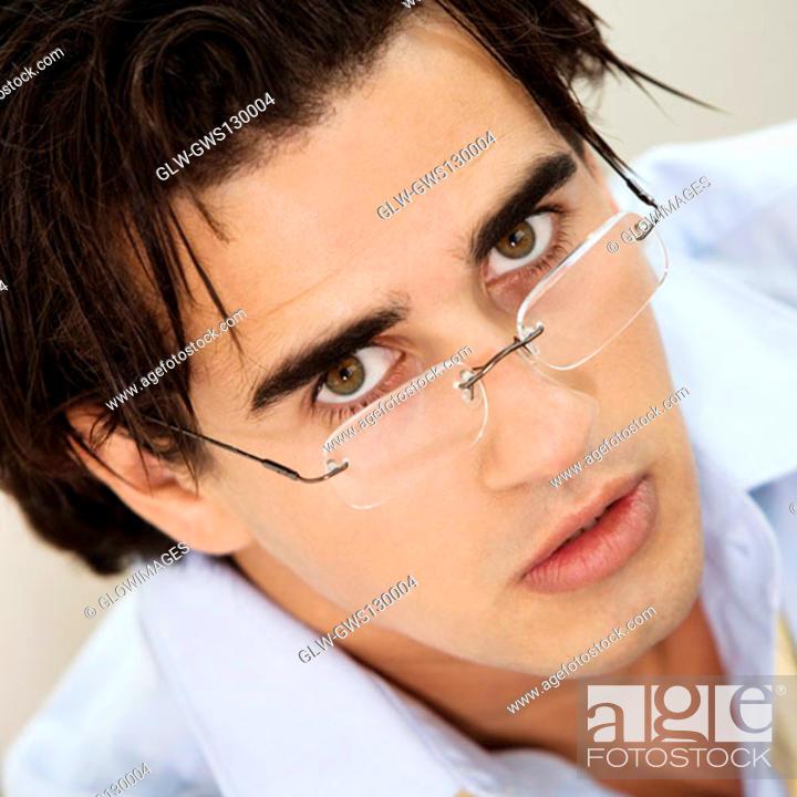Stock Photo: Portrait of a businessman wearing eyeglasses.