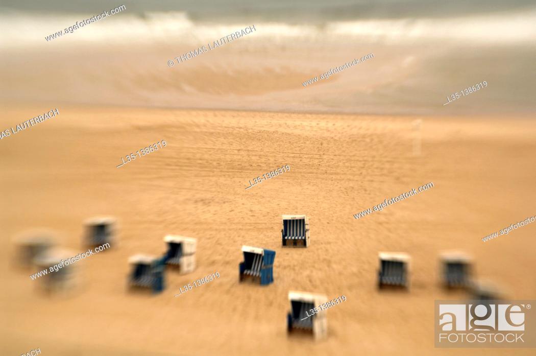Stock Photo: Beach chairs on the beach of Sylt, look like toys.