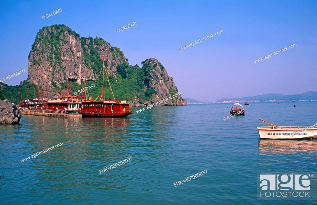 Stock Photo: Junk ships cruising through Halong Bay,Vietnam.