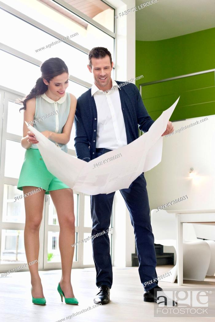 Stock Photo: Couple reading a blueprint.