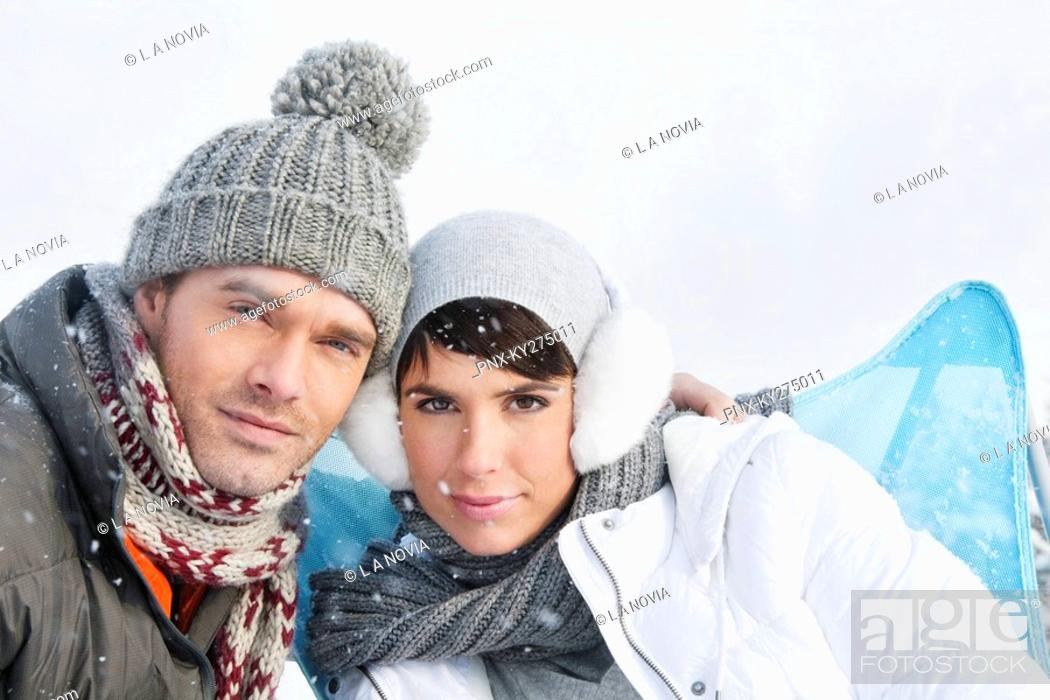 Stock Photo: Young couple in winter clothes looking at camera.