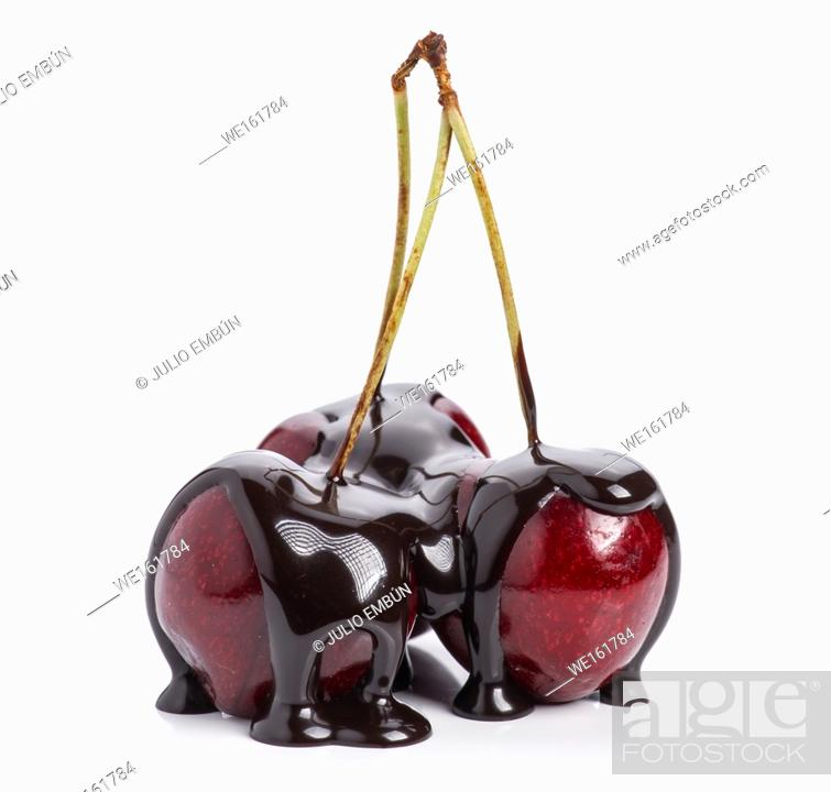 Stock Photo: bunch of cherries covered in chocolate isolated on white.