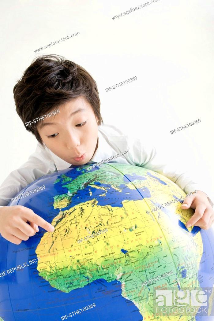 Stock Photo: boy holding a globe.