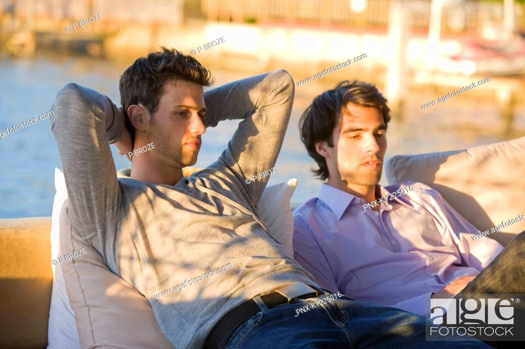 Stock Photo: Two friends sitting in a tourist resort.