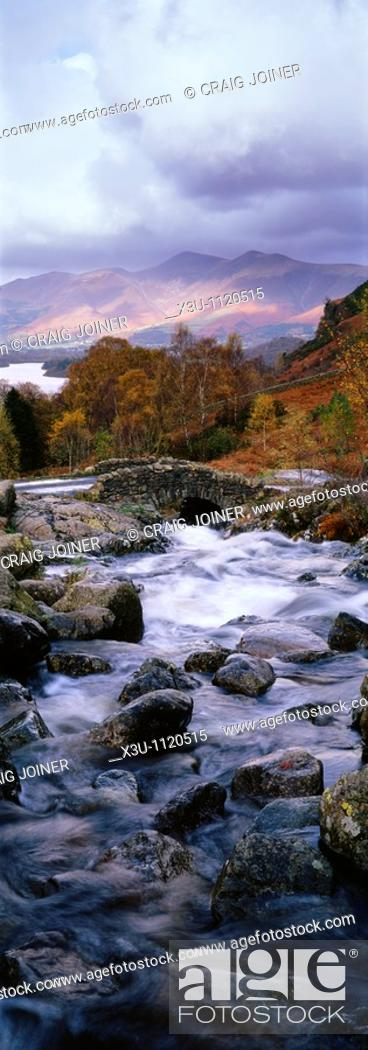 Stock Photo: Ashness Bridge near Keswick in the Lake District National Park, Cumbria, England, United Kingdom  Dewent Water and Skiddaw can be seen in the distance.