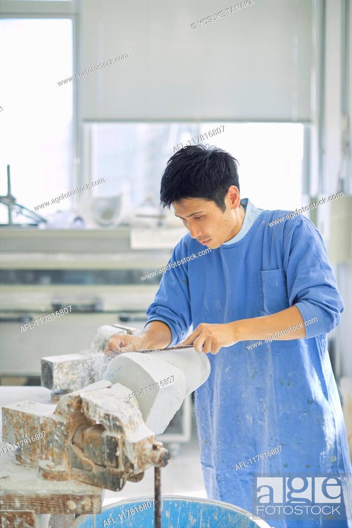 Stock Photo: Japanese prosthetist working in his studio.