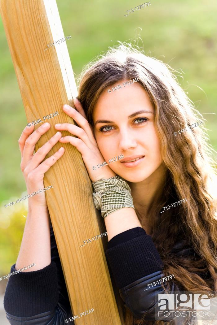 Stock Photo: Attractive girl portrait with a long curly hair.