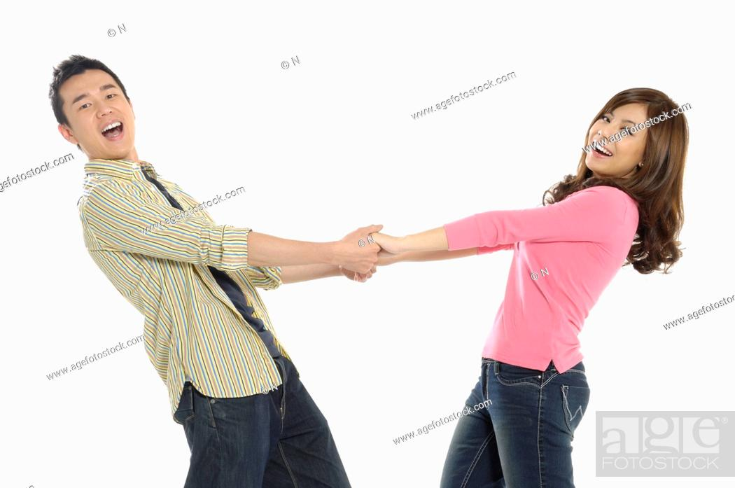Stock Photo: University students holding hands and smiling.