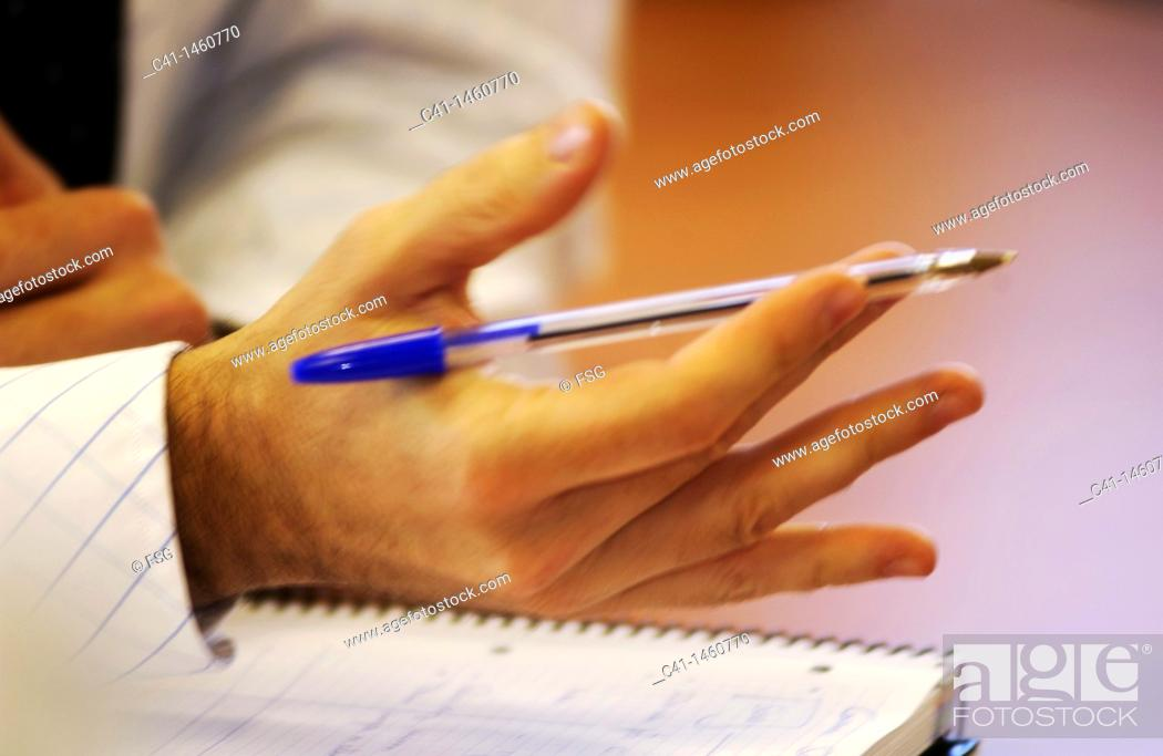 Stock Photo: Hands in a office.