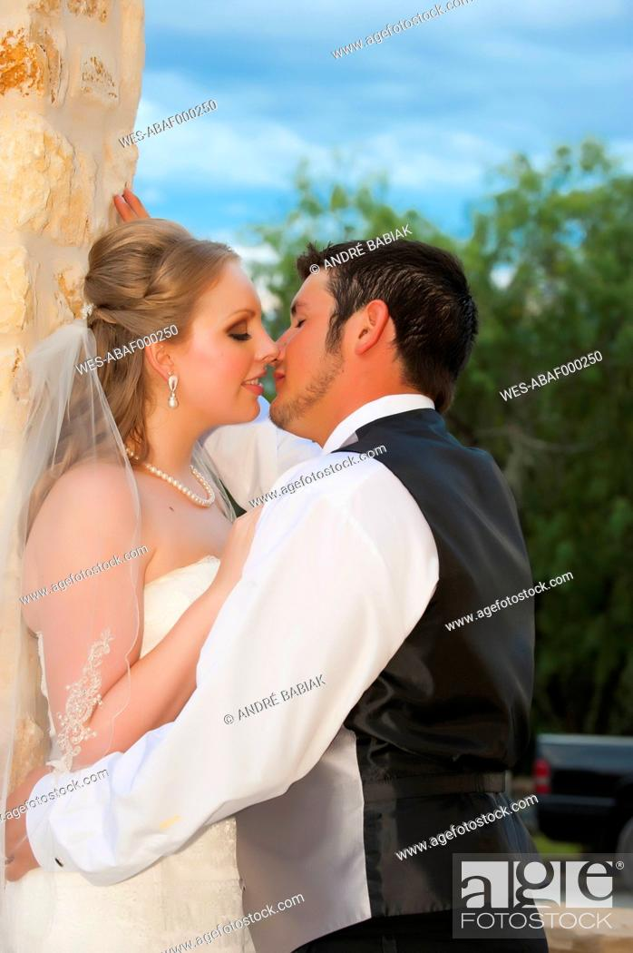 Stock Photo: USA, Texas, Bride and groom romancing, close up.