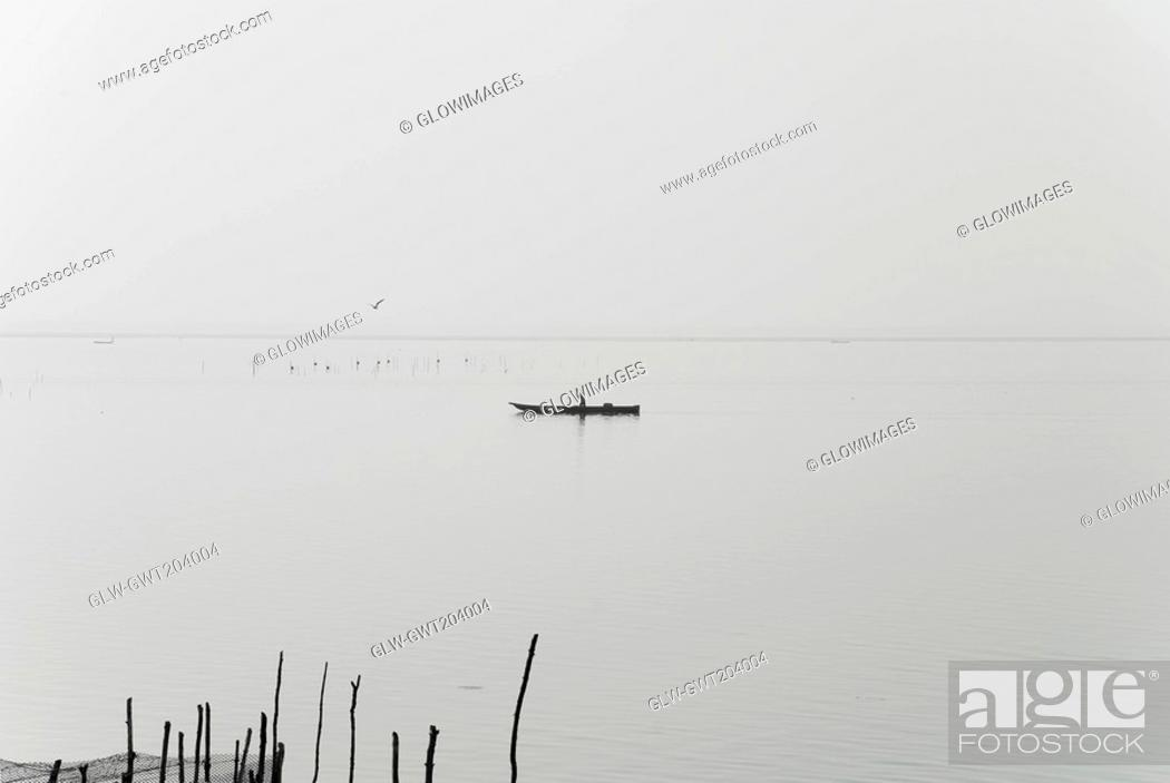 Stock Photo: Silhouette of a person boating in a river, Cienaga, Atlantico, Colombia.