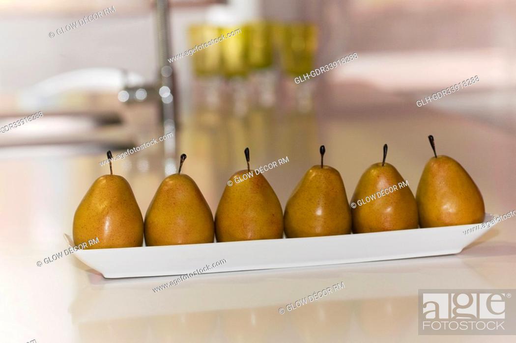 Photo de stock: Artificial pears on a table.